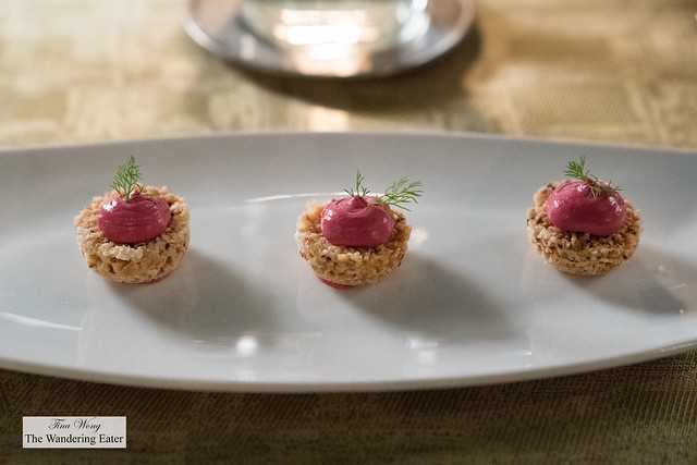 Amuse bouche of puffed rice cake and beet root and ricotta cheese