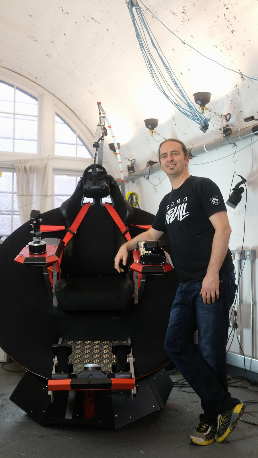 Feel Three founder, Mark Towner, with 3DOF motion simulator, London