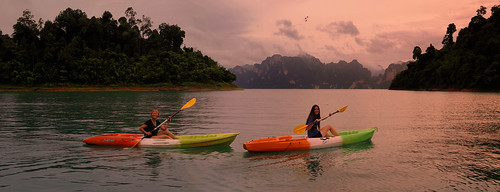 Kayaking through the lush and overgrown waterways deep in National Park Khao Sok