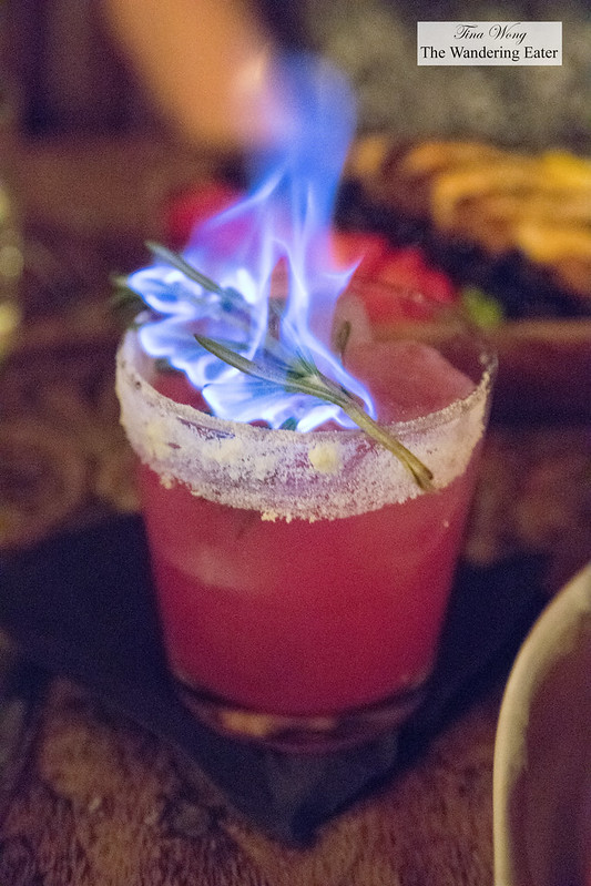Mezcali Me Banana - Prickly pear, mezcal, banana, lime, grapefruit, rimmed with habanero salt and charred rosemary