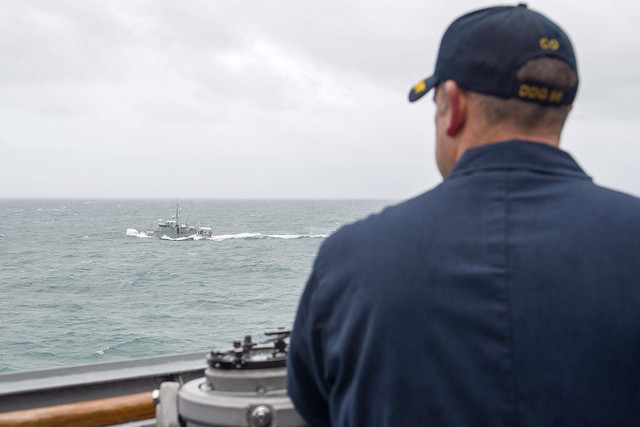 WATERS SOUTH OF FIJI (Oct. 17, 2018) Cmdr. Andy Strickland, commanding officer of the guided-missile destroyer USS Shoup (DDG 86), observes Republic of Fiji Military Forces RFNS Kikau (202) during a cooperative deployment in the Western Pacific. U.S. 3rd Fleet assets are trained and ready to operate alongside partners and allies throughout the region. (U.S. Navy photo by Mass Communication Specialist 2nd Class William Collins III/Released)