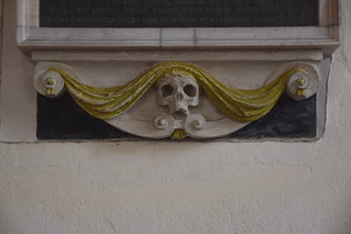 draped skull and scrollwork