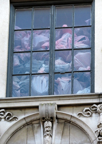 Pastel plastic bags piled up in a window in Dublin, Ireland