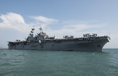 Wasp (LHD 1) approaches the pier at Changi Naval Base, Oct. 2. (U.S. Navy/Lt. Clyde Shavers)