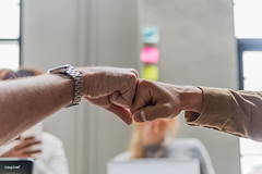 Two people giving a fist bump