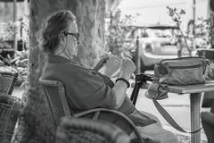 mature woman reads a newspaper