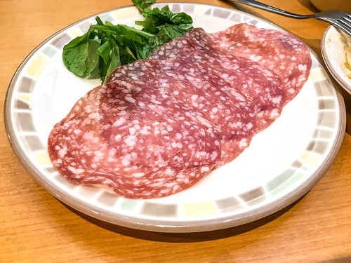 Milano Fermented Salami Salad in Plate on Table Italian food