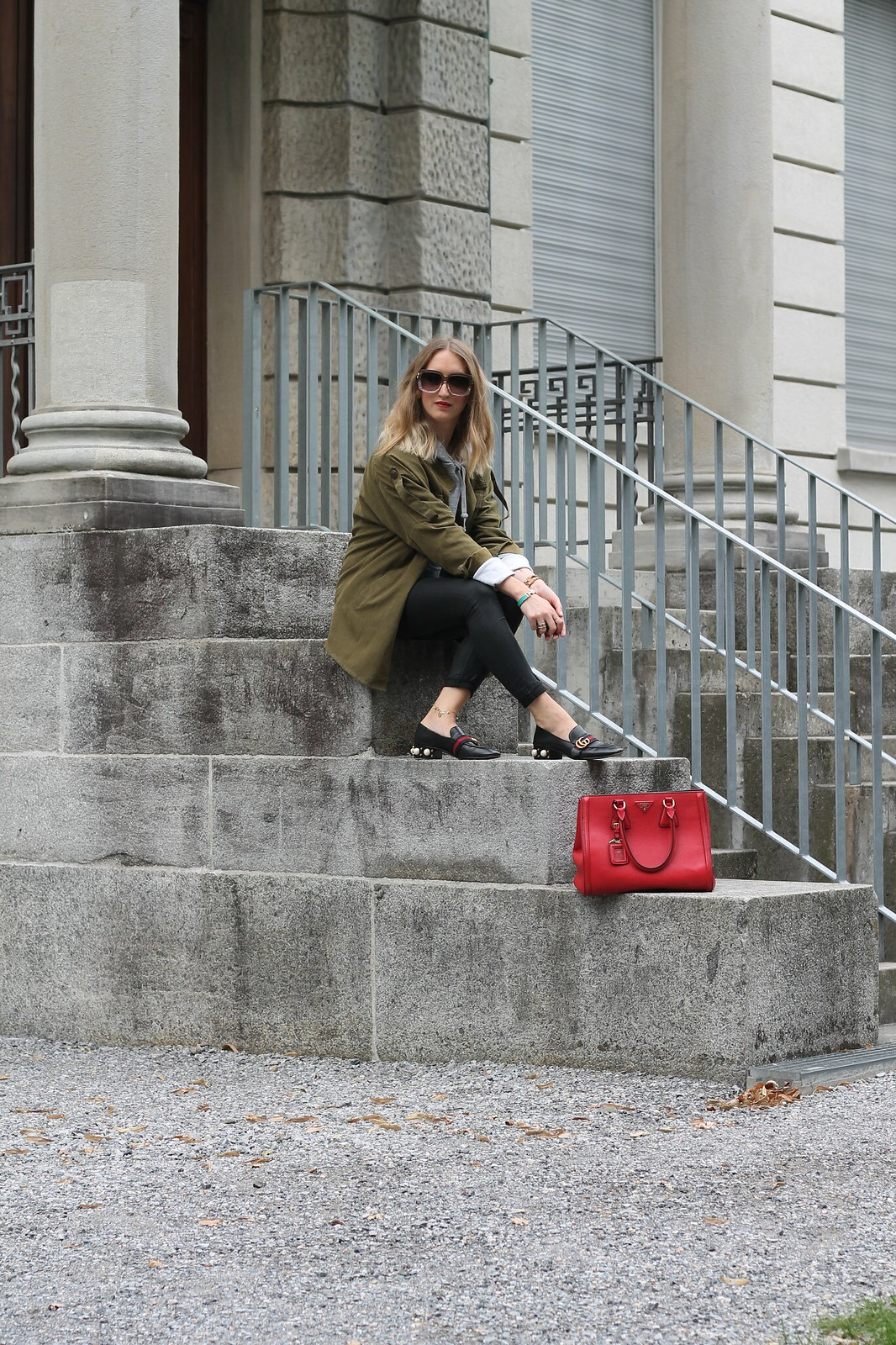 parka-and-prada-bag-sitting-front-whole-outfit-wiebkembg