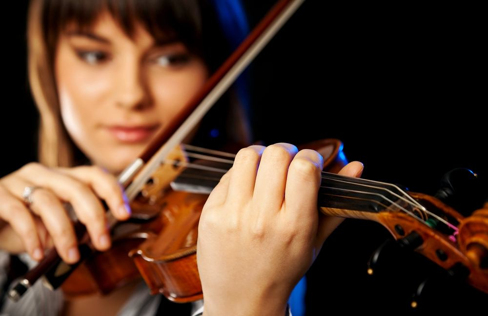 Woman practicing violin