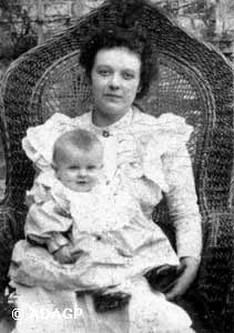 Magritte as a baby in his mother's lap