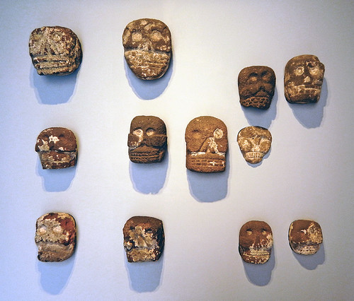Skulls carved out of rock in a museum in Puebla, Mexico