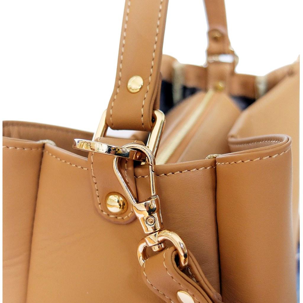 Beige color handbag valley