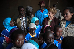 UNICEF Representative to Ethiopia, Ms. Gillian Mellsop and National ambassador to UNICEF Ethiopia, Tommy T. with children at  Homosha village,  in the Benishangul-Gumuz
