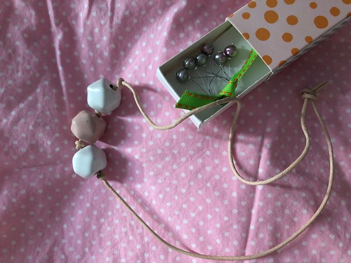 Making a simple ceramic bread necklace with waxed cotton cord. EvinOK.com