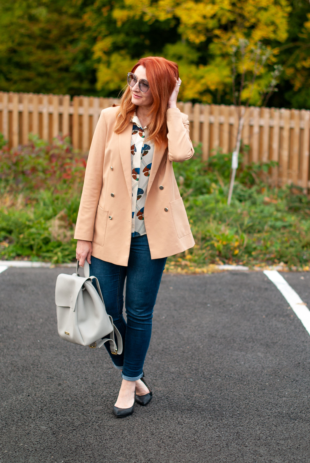 How to Make Jeans Smart for an Informal Meeting \ camel blazer \ dark wash skinny jeans \ patterned blouse \ block heel black shoes \ light grey backpack | Not Dressed As Lamb, over 40 style