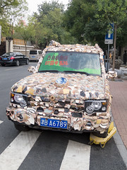 Pottery covered Land Rover