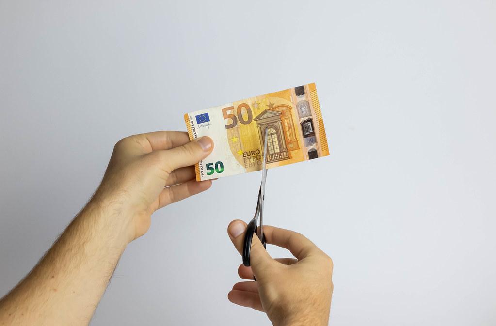 Scissors cut Euro banknote