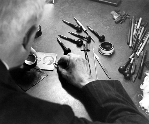 Engraver Elie Timothée Loizeaux at work. Born in Vinton, Iowa, on March 4, 1873, Loizeaux started as an apprentice engraver at the American Bank Note Co. in 1892 and remained in there until his retirement in 1947. He was one of the last great master engravers of the golden age of steel engraving at ABNC. He worked side-by-side with legendary engravers as Charles Skinner, Robert Savage and Edwin Gunn. Elie T. Loizeaux died on August 6, 1956.