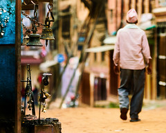 Man walking away from a Hindu Shrine in Bhaktapur, Nepal