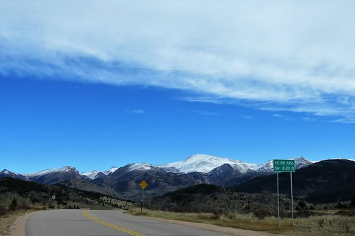 mountains mountain mountainpass victor colorado victorpass clouds pikespeak road rural autumn snow pass highcountry sign cattleguard signs tellercounty pathscaminhos