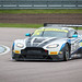 Paul Andrew Rigby posted a photo:	Aston Martin V12 Vantage GT3 (Optimum Motorsport) rounds Rockingham Motor Speedway's Tarzan corner during the British GT Championships.