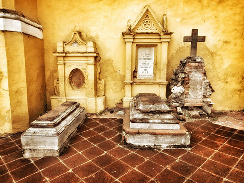 Tombs at one of the yellow churches in Cholula, Mexico, run through the photo app Snapseed