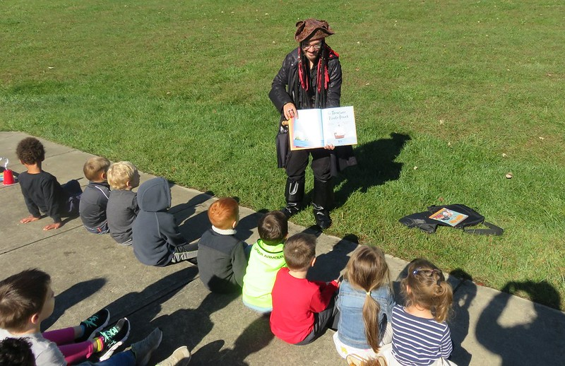 Enjoying our StoryWalk at Dominick Lofino Park with a pirate