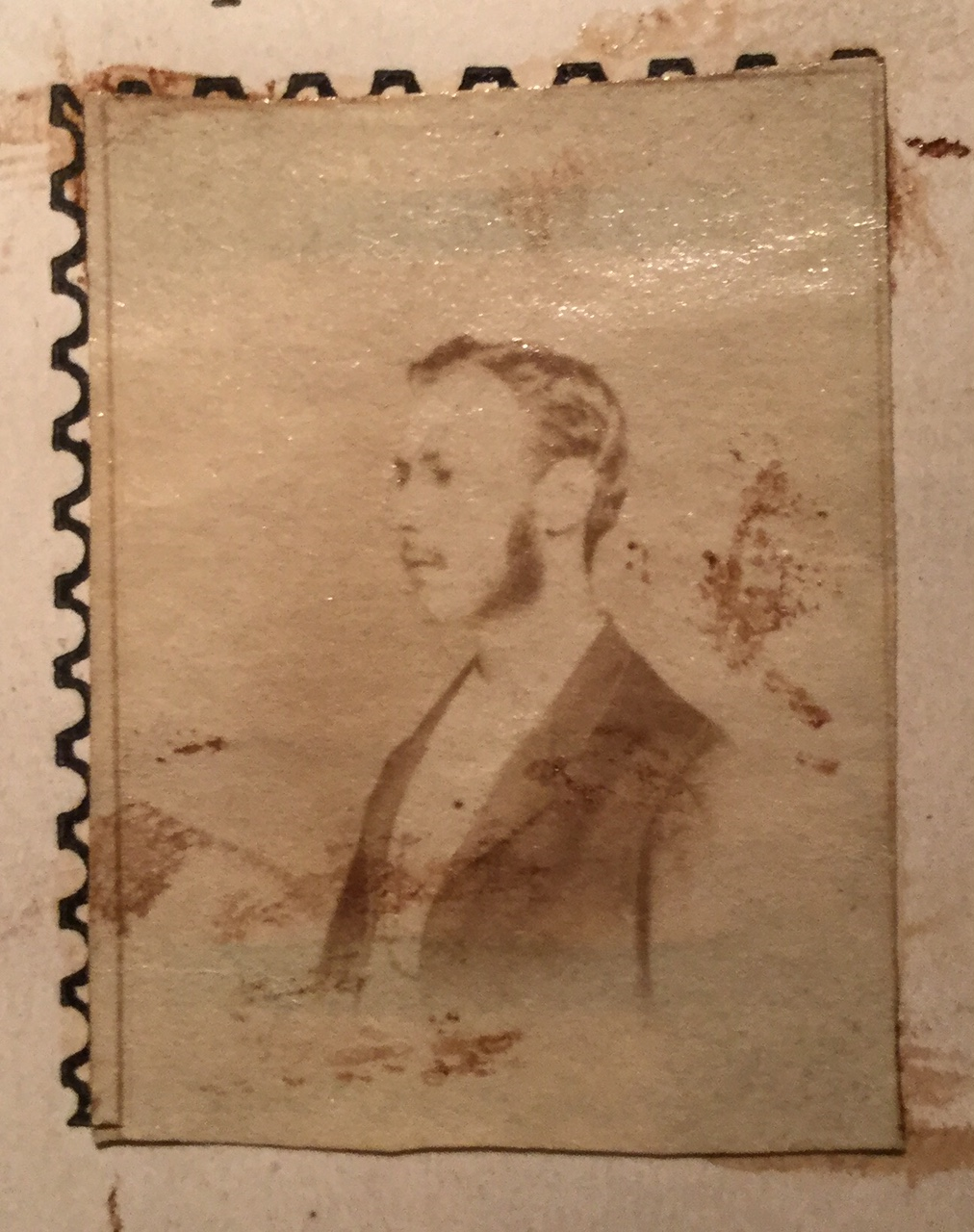 John Walter Scott portrait used as a label to be placed in his Postage Stamp Album copyright 1869, photographed in 2016 from the second edition album of 1870, showing actual use in an album. Sourced from Wikipedia.
