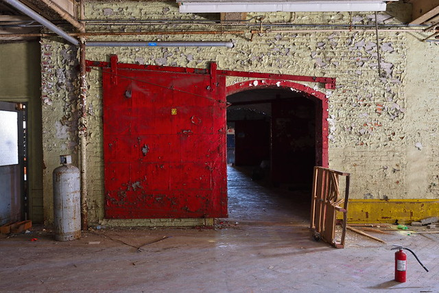 Mill fire door with extinguisher