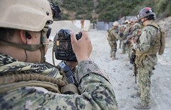 AZUSA, Calif. (May 23, 2017) Mass Communication Specialist 2nd Class Antonio Turretto Ramos, assigned to Fleet Combat Camera Pacific (FCCP), documents close quarters battle training during FCCP's exercise Summer Quick Shot 2017. Quick Shot is a biannual FCCP exercise that provides live-fire and visual information training to joint combat camera assets. (U.S. Navy photo by Mass Communication Specialist 3rd Class Zachary S. Eshleman)
