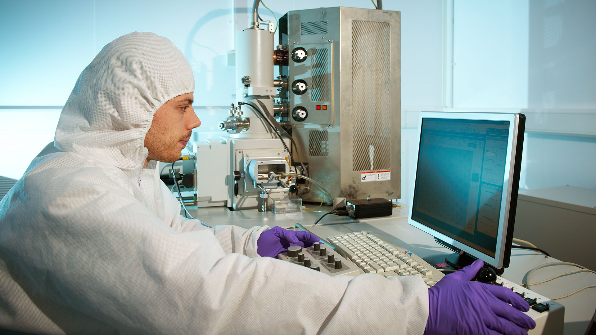 Researcher working at the electron beam lithography system at the University of Bath