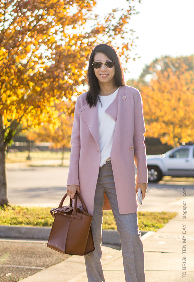 pink wool draped front open jacket, white fringe sweater tee, gray trousers, brown tote