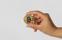 Girl holding Bitcoin