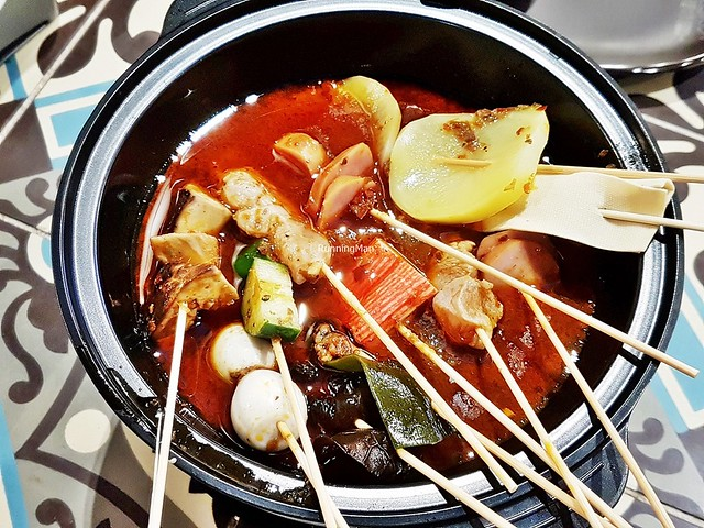 Assorted Skewers In Red Hot Chili Pot