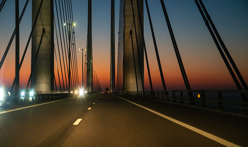 bridge driving sweden crossing street malmo night construction asphalt sky denmark summer design light malmoe sea silhouette oresund scandinavia infrastructure architecture blue color outdoors perspective traffic skyline oresundsbron sunrise transport cross highway landmarks oeresund colorful