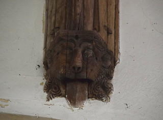 corbel: lion with its tongue out (early 16th Century?)
