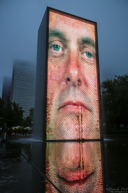 Waterfall lit by an image of a face behind it