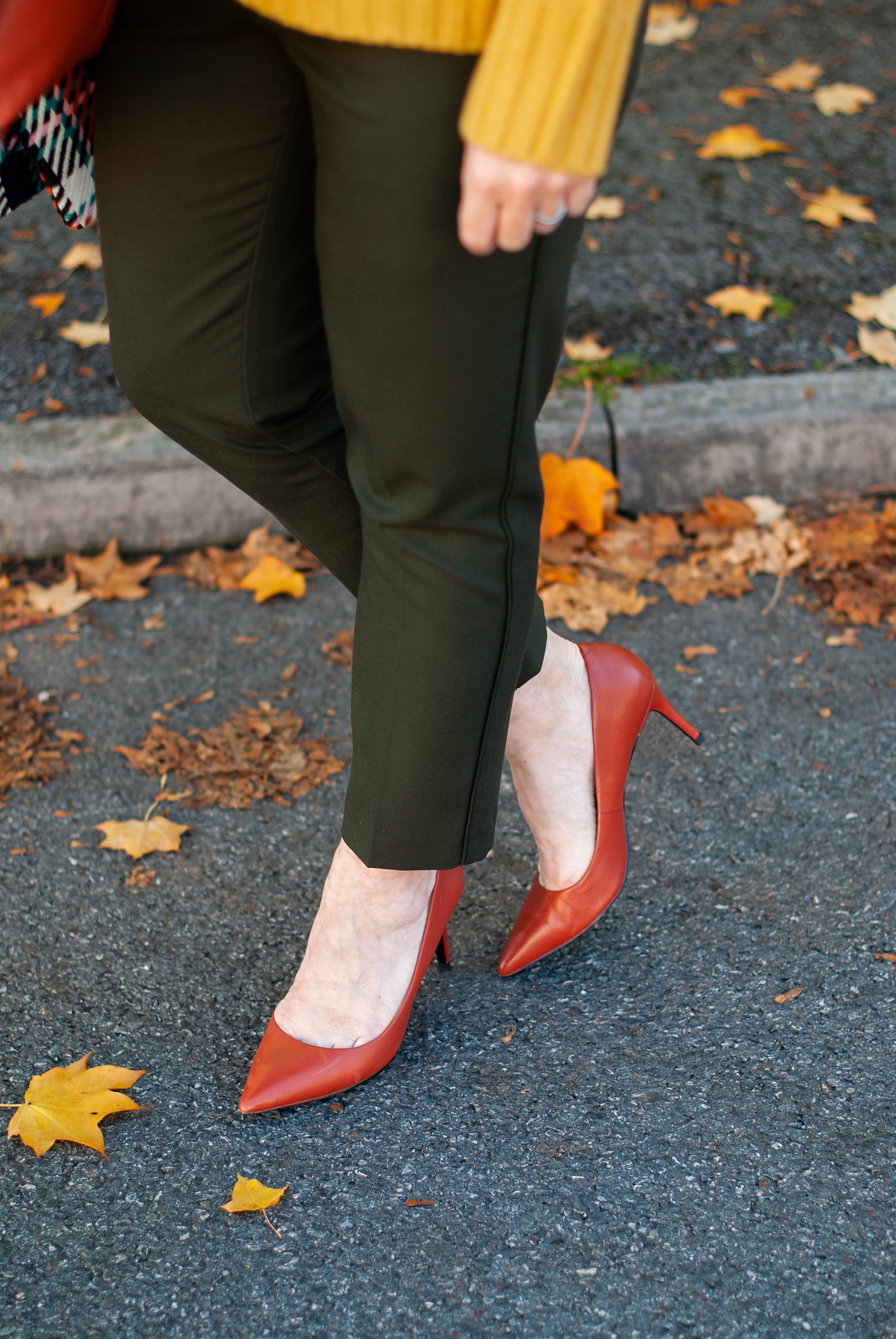 Dressing in Bold, Saturated Autumnal Colours \ check statement coat \ bottle green trousers \ burnt orange heels \ burnt orange suede messenger bag \ mustard yellow sweater | Not Dressed As Lamb, over 40 style