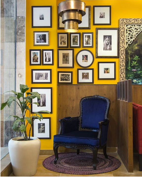 Gallery wall on mustard background
