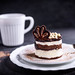 Chocolate cake served with cup of coffee by wuestenigel
