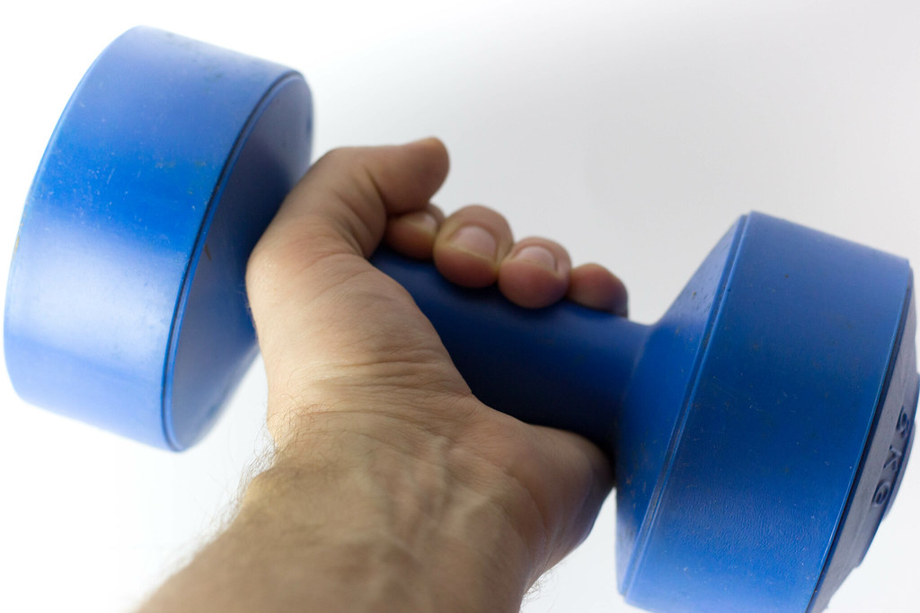 Hand Holding Lifting Weight Dumbbell_