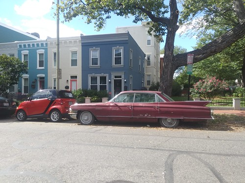 Small and big, a SmartCar and a very old Cadillac on 9th Street NE
