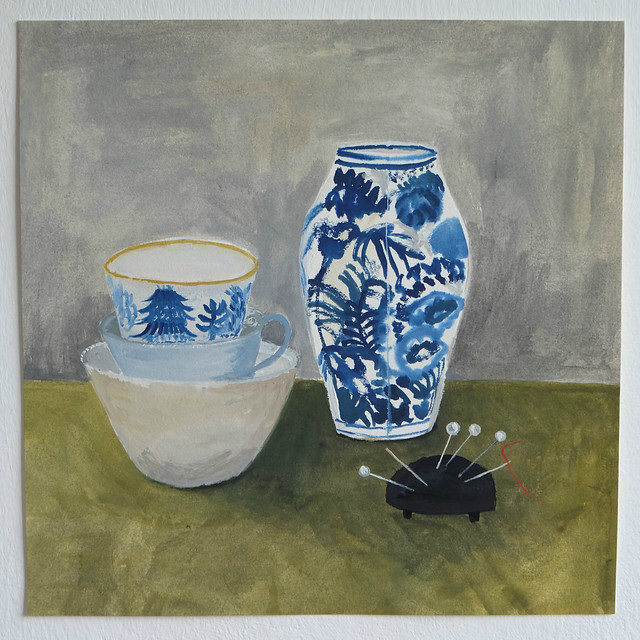 still life with blue and white ceramics and pin cushion