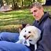 David cuddling Bella, American Eskimo dog by daveynin