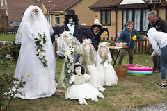 Wedding party scarecrows.