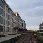 After the evening storm in the Winston-Salem Innovation Quarter: railroad tracks through the restored factories