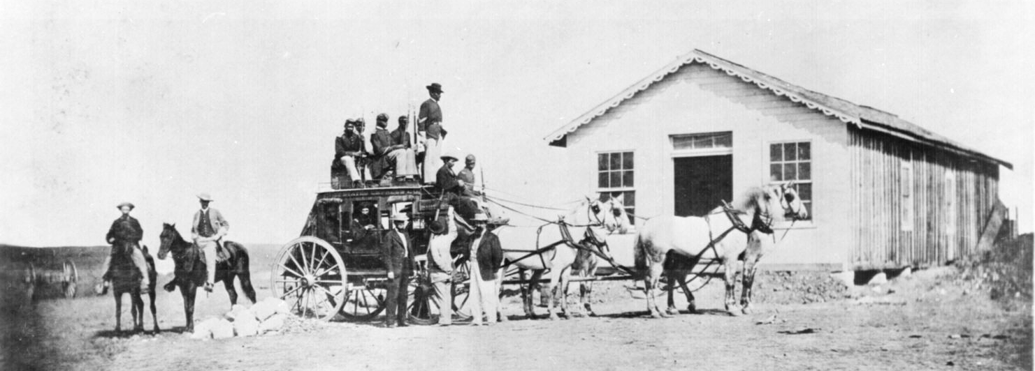 Typical stagecoach of the Concord type used by express companies on the overland trails, circa 1869. Buffalo soldiers guard from atop.