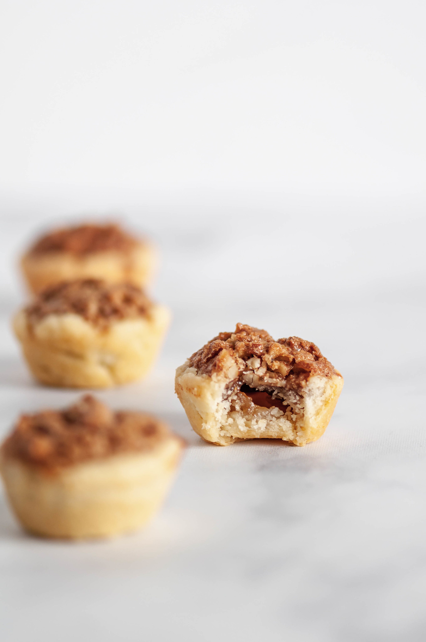 Mini Pecan Pies have all the traditional flavor of a traditional pecan pie in mini form and without the corn syrup. Only 40 minutes from start to finish make these a simple and delicious option for your Thanksgiving dessert table.