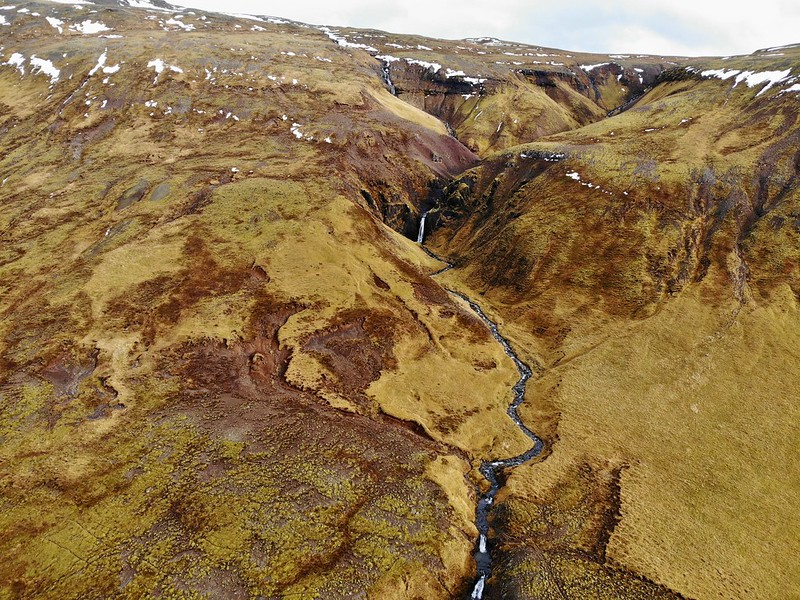 drone photo of a secret waterfall in Iceland
