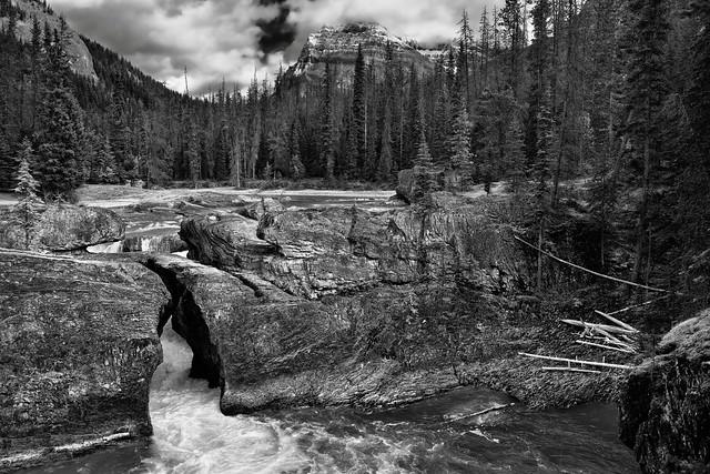 Carving a Path Through the Rocks of Natural Bridge (Black & White, Yoho National Park)